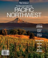 """Magazine cover with text """"Wine Enthusiast - The Winelover's Guide to the Pacific Northwest"""" depicting a vineyard in the foreground and a snowcapped mounted in the background."""